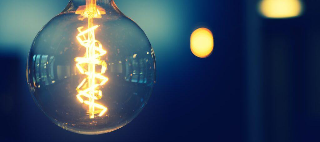 Lightbulb glowing in dark